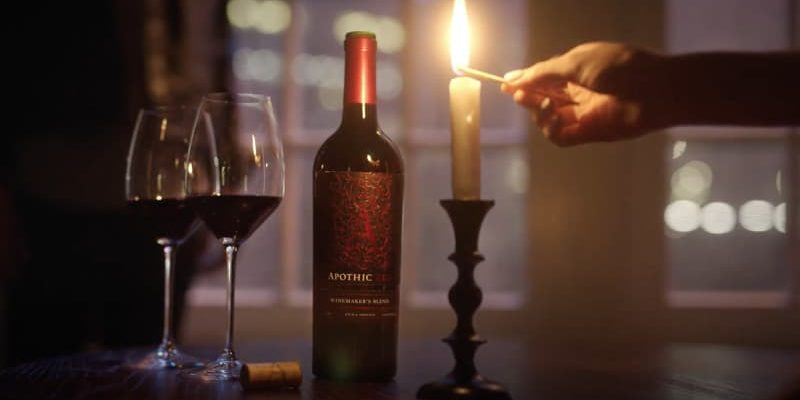Candle and wine bottle